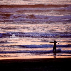 Kid Wave Jumping at Sunset