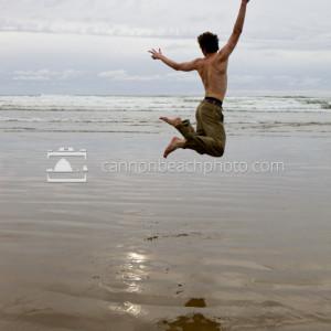 Man Jumping for Joy on Beach