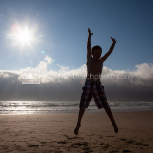 Child Jumping for Joy in Cannon Beach