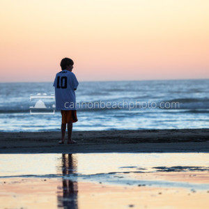 Child Standing on Sunset Seashore