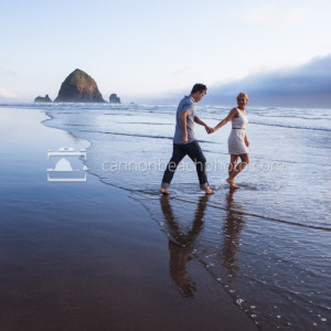 Couple Walking into the Pacific Hand in Hand