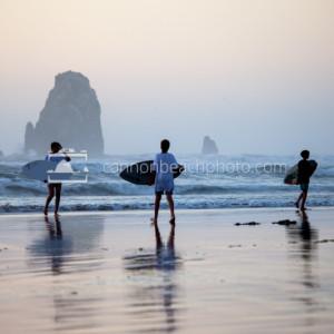 Three Kids Skimboarding Evening in Cannon Beach, Oregon