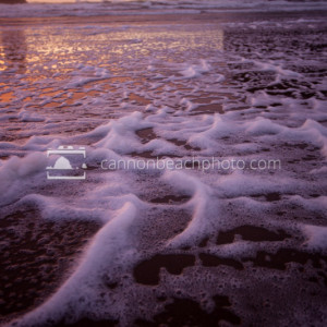 Beach Foam at Stormy Sunset