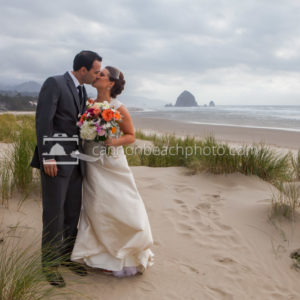 Wedding Couple Kissing in the Dunes