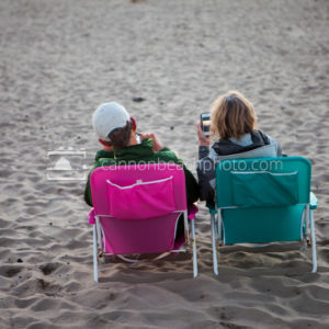 Couple Snapping Sunset from Their Chairs
