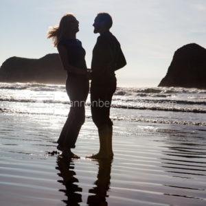 Silhouetted Couple Dancing on the Shoreline