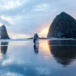 Couple near Haystack Rock at Sunset