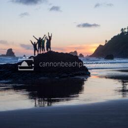 Hi-Five Group Celebrating at Sunset