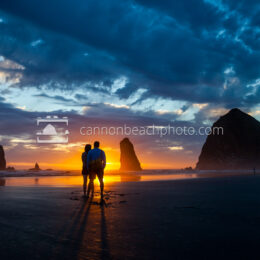 Couple Silhouetted at Haystack by the Sunset