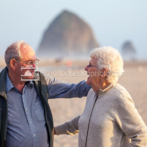 Elderly Couple Joyful on the Beach