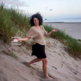 Woman Smiling While Walking Down Dunes