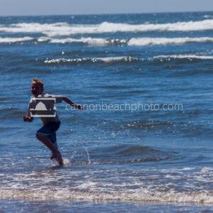 Boy Running in the Ocean