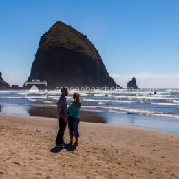 Couple Talking Near Haystack Rock
