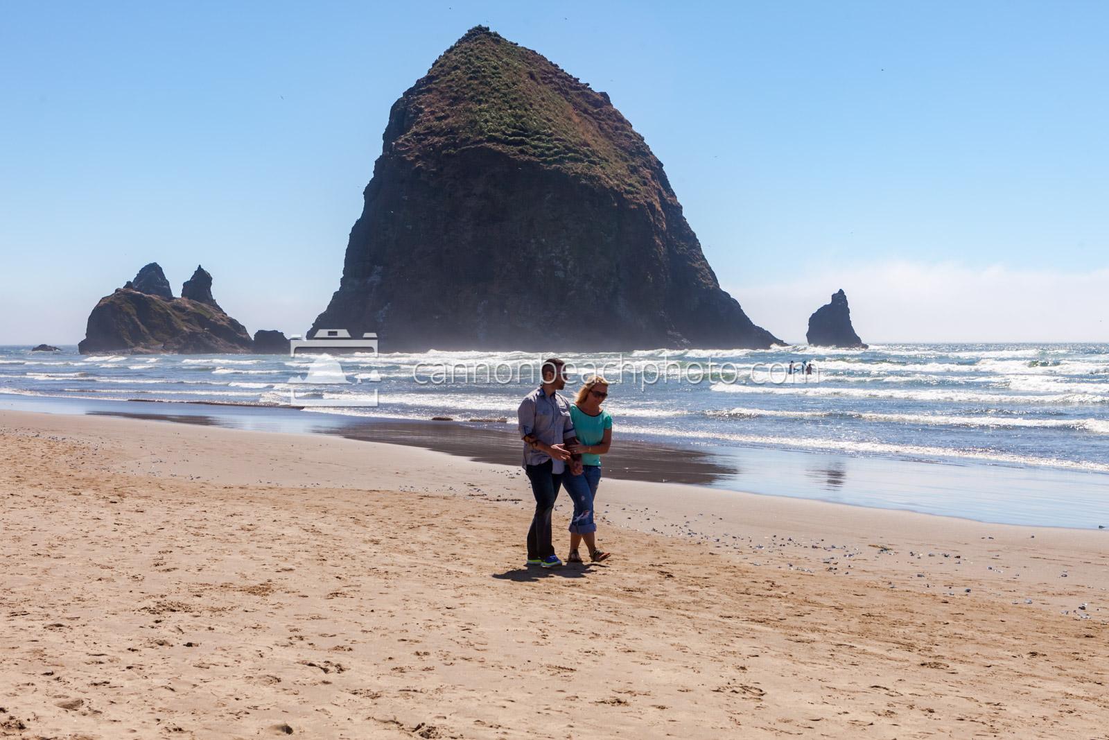 Couple Walking Near Haystack Rock, Horizontal