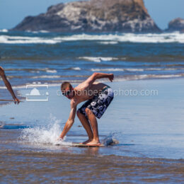 Guy Skimboarding at Ecola Creek