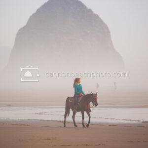Woman Riding Horseback on a Foggy Day Near Haystack Rock 1