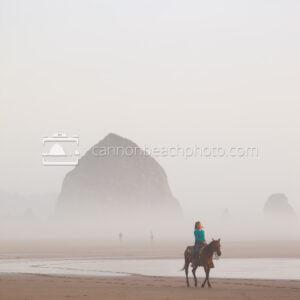 Woman Riding Horseback on a Foggy Day Near Haystack Rock 2