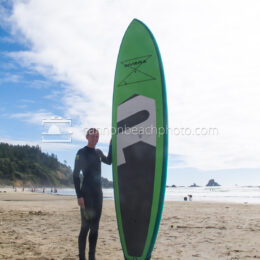 Young Man with Paddle Board