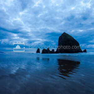 Wide View of Dynamic Blue Clouds Over Haystack Rock 1