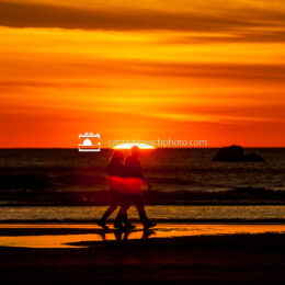 Couple Walking as the Sun Drops