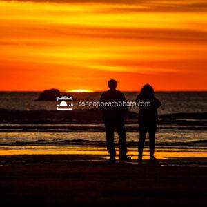 Couple Watching the Sun Drop Below