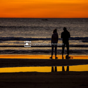 Silhouetted Couple in Yellow Sunset, Horizontal